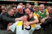 4 June 2000; Offaly's Vinny Claffey celebrates with supporters following the Bank of Ireland Leinster Senior Football Championship Quarter-Final match between Offaly and Meath at Croke Park in Dublin. Photo by Damien Eagers/Sportsfile