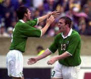 4 June 2000; Richard Dunne celebrates with his Republic of Ireland team-mate Gary Breen, left, after scoring their opening goal during the US Nike Cup game between Republic of Ireland and Mexico at Soldier Field in Chicago, Illnois, USA. Photo by David Maher/Sportsfile