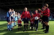 22 July 2000; Derek Swan of Bohemians is given a guard of honour by both teams as he comes out with his children Anthony, Ryan, Leah and Derek ahead of his Testimonial match between Bohemians and Tranmere Rovers at Dalymount Park in Dublin. Photo by David Maher/Sportsfile