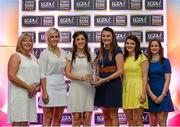 29 May 2015; Accepting the TESCO / Irish Daily Star Ladies Football Manager of the Year on behalf of Eamonn Ryan are Cork players, second from left, Bríd Stack, Ciara O'Sullivan, Annie Walsh and Marie Ambrose, with Marie Hickey, LGFA President, far left, and Lynn Moynihan, Tesco Marketing Manager, far right. TESCO Team of the League, Croke Park, Dublin. Picture credit: Piaras Ó Mídheach / SPORTSFILE