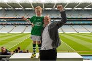 30 May 2015; Derry great Anthony Tohill with Dáithi Mohan, aged 7, from Donagh, Fermanagh, at today's Bord Gáis Energy Legends Tour at Croke Park where he relived some of most memorable moments from his playing and managerial career. All Bord Gáis Energy Legends Tours include a trip to the GAA Museum, which is home to many exclusive exhibits, including the official GAA Hall of Fame. For booking and ticket information about the GAA legends for this summer's tours visit www.crokepark.ie/gaa-museum. Croke Park, Dublin. Picture credit: Piaras Ó Mídheach / SPORTSFILE