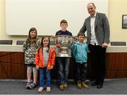 30 May 2015; Derry great Anthony Tohill with Saoirse Davey, aged 7, Nessa Davey, aged 6, Mikey Davey, aged 11, and Fionn Davey, aged 6, all from Bannow, Wexford, at today's Bord Gáis Energy Legends Tour at Croke Park where he relived some of most memorable moments from his playing and managerial career. All Bord Gáis Energy Legends Tours include a trip to the GAA Museum, which is home to many exclusive exhibits, including the official GAA Hall of Fame. For booking and ticket information about the GAA legends for this summer's tours visit www.crokepark.ie/gaa-museum. Croke Park, Dublin. Picture credit: Piaras Ó Mídheach / SPORTSFILE
