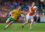 14 June 2015; Kevin Dyas, Armagh, in action against Michael Murphy, Donegal. Ulster GAA Football Senior Championship Quarter-Final, Armagh v Donegal. Athletic Grounds, Armagh. Picture credit: Oliver McVeigh / SPORTSFILE