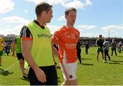 14 June 2015; Armagh manager Kieran McGeeney leaves the field with Finnian Moriarty after the game. Ulster GAA Football Senior Championship Quarter-Final, Armagh v Donegal. Athletic Grounds, Armagh. Picture credit: Oliver McVeigh / SPORTSFILE