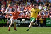 14 June 2015; Martin McElhinney, Donegal, in action against Finnian Moriarty, Armagh. Ulster GAA Football Senior Championship Quarter-Final, Armagh v Donegal. Athletic Grounds, Armagh. Picture credit: Oliver McVeigh / SPORTSFILE