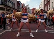 Members of the Crown Jewels Cheerleaders, from left, Lisa Burston, Kerry Jenkins and Natasha Merogno who were in Grafton Street today (Tues) to promote the Budweiser American Bowl which takes place in Croke Park on Sunday.   Photograph Ray McManus SPORTSFILE