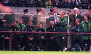 Rep of Ireland manager Mick McCarthy in a happy mood with the rest of the bench against Liechtenstein at Lansdowne Rd. Rep of Ireland (5) v Liechtenstein (0). 21/5/97. Soccer. Photograph: Brendan Moran SPORTSFILE.