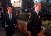 Former Rep of Ireland Manager Jack Charlton and Maurice Setters pictured yesterday on their way into Davitt House, Dublin, for an unfair dismissal charge against the F.A.I. Pic David Maher/Sportsfile.