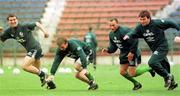 Roy Keane, David Connolly, Terry Phelan and Ray Houghton pictured during an Irish squad training session in the Steuea Stadium, Bucharest. 29/4/97. Soccer. Photograph: David Maher SPORTSFILE.