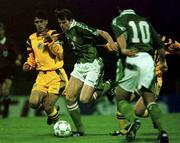 Rep of Ireland's Kevin KILBANE races past Romania's Marius BACIU and Iulian MIU (Ireland 10 is Neale FENN) during their U-21 match at the National Stadium, Bucharest. Soccer. 29/4/97. Photograph: David Maher SPORTSFILE.