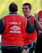 Roy Keane, centre, shares a joke with Terry Phelan and Alan Kelly, right. during a training session in the Controceni Stadium in Bucharest, Romania. Soccer. Mon 28/4/97. Photograph: David Maher SPORTSFILE.