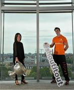 16 June 2015; Dublin football star Michael Darragh MacAuley with Lisa Comerford, Director of Brand and Communications, eircom, before they joined eircom's GAA ambassadors Tomás O'Sé, Ciaran Whelan, David Brady and Brendan Devenney in eircom's head office in Dublin to launch their online platform for supporters of this summer's GAA Football All-Ireland Senior Championship. The GAA hub, www.eircom.ie/gaa, will see the introduction of a new feature where fans can record and share their views on players throughout the championship via a new audio social network BOAST and be in with a chance to win tickets to the All-Ireland Senior Football Final. #shoutitout. eircom Head Office, HSQ, Dublin. Picture credit: Brendan Moran / SPORTSFILE
