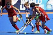 18 June 2015; Megan Frazer, Ireland, in action against Qian Yu and Qiuxia Cui, China. Women's World League Round 3, Ireland v China. Valencia, Spain. Picture credit: David Aliaga / SPORTSFILE