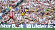 31 August 2008; Ciaran Lyng, Wexford, beats Colin Holmes, Tyrone to score his side's first goal. GAA Football All-Ireland Senior Championship Semi-Final, Tyrone v Wexford, Croke Park, Dublin. Picture credit: David Maher / SPORTSFILE