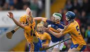 25 June 2015; Martin Daly, left, and Darren Chaplin, Clare, in action against Emmet Moloney, Tipperary. 2015 Electric Ireland Munster GAA Hurling Minor Championship, Clare v Tipperary. Semple Stadium, Thurles, Co. Tipperary. Picture credit: Ray McManus / SPORTSFILE