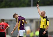 27 June 2015; Adrian Flynn, Wexford, is black carded by referee Cormac Reilly. GAA Football All-Ireland Senior Championship, Round 1B, Wexford v Down. Innovate Wexford Park, Wexford. Picture credit: Matt Browne / SPORTSFILE