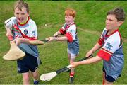 3 July 2015; From left, Marc Grant, Cillian Small and Ruan O'Connor, all 10, are pictured at the very first 'Kellogg's Powering Play' workshop, a new fun game based nutritional module that is being piloted by Kellogg's and the GAA this summer at selected Cúl Camps to help promote the benefits of physical activity and eating well. Cuala GAA Club, Dalkey, Co. Dublin. Picture credit: Cody Glenn / SPORTSFILE