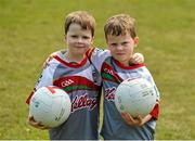 3 July 2015; Cullen, left, 5, and Éanna O'Keeffe, 6, from Cabinteely, pictured at the very first 'Kellogg's Powering Play' workshop, a new fun game based nutritional module that is being piloted by Kellogg's and the GAA this summer at selected Cúl Camps to help promote the benefits of physical activity and eating well. Cuala GAA Club, Dalkey, Co. Dublin. Picture credit: Piaras Ó Mídheach / SPORTSFILE