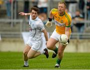 4 July 2015; Alan Mulhall, Offaly, in action against Niall Kelly, Kildare. GAA Football All-Ireland Senior Championship, Round 2A, Offaly v Kildare. O'Connor Park, Tullamore, Co. Offaly. Picture credit: Piaras Ó Mídheach / SPORTSFILE