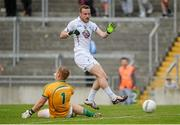 4 July 2015; Alan Smith, Kildare, beats Offaly goalkeeper Alan Mulhall, but his shot was cleared off the line by Niall Darby. GAA Football All-Ireland Senior Championship, Round 2A, Offaly v Kildare. O'Connor Park, Tullamore, Co. Offaly. Picture credit: Piaras Ó Mídheach / SPORTSFILE