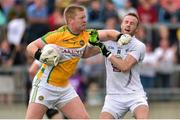 4 July 2015; Offaly goalkeeper Alan Mulhall tussles with Alan Smith, Kildare after Kildare's goal. GAA Football All-Ireland Senior Championship, Round 2A, Offaly v Kildare. O'Connor Park, Tullamore, Co. Offaly. Picture credit: Cody Glenn / SPORTSFILE