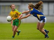 4 July 2015; Sarah Harkin, Donegal, in action against Marie Creedon, Tipperary. All Ireland Ladies Football U14 'B' Championship, Donegal v Tipperary. Ballymahon, Co. Longford. Picture credit: David Maher / SPORTSFILE