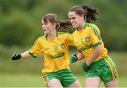 4 July 2015; Saoire Bonner, right, Donegal, celebrates after scoring her side's first goal with team-mate Kate McClenaghan. All Ireland Ladies Football U14 'B' Championship, Donegal v Tipperary. Ballymahon, Co. Longford. Picture credit: David Maher / SPORTSFILE