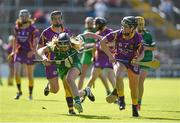 4 July 2015; Rebecca Delee, Limerick, in action against Shauna Sinnott, Wexford. Liberty Insurance Camogie Championship, Wexford v Limerick. Innovate Wexford Park, Wexford. Picture credit: Matt Browne / SPORTSFILE