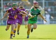 4 July 2015; Aoife Sheehan, Limerick, in action against Stacey Kehoe, Wexford. Liberty Insurance Camogie Championship, Wexford v Limerick. Innovate Wexford Park, Wexford. Picture credit: Matt Browne / SPORTSFILE