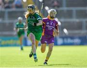 4 July 2015; Rebecca Delee, Limerick, in action against Kate Kelly, Wexford. Liberty Insurance Camogie Championship, Wexford v Limerick. Innovate Wexford Park, Wexford. Picture credit: Matt Browne / SPORTSFILE