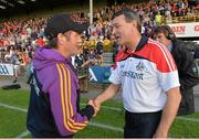 4 July 2015; Wexford manager Liam Dunne congratulates Cork manager Jimmy Barry-Murphy after the game. GAA Hurling All-Ireland Senior Championship, Round 1, Wexford v Cork. Innovate Wexford Park, Wexford. Picture credit: Matt Browne / SPORTSFILE