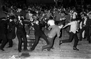Sept 1984. Glasgow Rangers supporters clash with the Gardai at Dalymount Pk during the UEFA Cup game. Bohemians v Glasgow Rangers. Picture credit; Ray McManus/SPORTSFILE