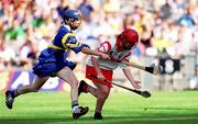 3 September 2000; Ciara Healy of Cork in action against Una O'Dwyer of Tipperary during the All-Ireland Senior Camogie Championship Final match between Cork and Tipperary at Croke Park in Dublin. Photo by Aoife Rice/Sportsfile