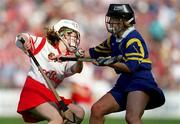 3 September 2000; Elaine Burke of Cork in action against Claire Madden of Tipperary during the All-Ireland Senior Camogie Championship Final match between Cork and Tipperary at Croke Park in Dublin. Photo by Aoife Rice/Sportsfile