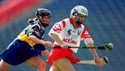3 September 2000; Una O'Donoghue of Cork in action against Suzanne Kelly of Tipperary during the All-Ireland Senior Camogie Championship Final match between Cork and Tipperary at Croke Park in Dublin. Photo by Brendan Moran/Sportsfile
