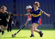 3 September 2000; Elaine Burke of Cork in action against Therese Brophy of Tipperary during the All-Ireland Senior Camogie Championship Final match between Cork and Tipperary at Croke Park in Dublin. Photo by Brendan Moran/Sportsfile
