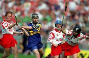 3 September 2000; Emer McDonnell of Tipperary in action against Linda Mellerick, left, and Ursula Troy of Cork during the All-Ireland Senior Camogie Championship Final match between Cork and Tipperary at Croke Park in Dublin. Photo by Aoife Rice/Sportsfile