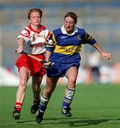 3 September 2000; Angela McDermott of Tipperary in action against Linda Mellerick of Cork during the All-Ireland Senior Camogie Championship Final match between Cork and Tipperary at Croke Park in Dublin. Photo by Aoife Rice/Sportsfile
