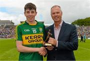 5 July 2015; Pictured is John Drinan, Customer Relationship Manager for Electric Ireland, proud sponsor of the GAA All-Ireland Minor Championships, presenting Conor Geaney, Kerry, with the Player of the Match award for his outstanding performance in the Electric Ireland Munster Minor Football Championship Final. Throughout the Championship fans can follow the action, support the Minors and be a part of something major through the hashtag #ThisIsMajor. Fitzgerald Stadium, Killarney, Co. Kerry. Picture credit: Brendan Moran / SPORTSFILE