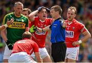 5 July 2015; Cork's Mark Collins, 3rd from right, reacts as referee Padraig Hughes awards a penalty to Kerry. Munster GAA Football Senior Championship Final, Kerry v Cork. Fitzgerald Stadium, Killarney, Co. Kerry. Picture credit: Brendan Moran / SPORTSFILE