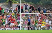 5 July 2015; Micheal Shields, left, Cork, celebrates after his side score their third goal. Munster GAA Football Senior Championship Final, Kerry v Cork. Fitzgerald Stadium, Killarney, Co. Kerry. Picture credit: Eoin Noonan / SPORTSFILE