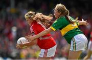 5 July 2015; Molly Kelleher, Ballygarvan NS, Cork, is tackled by Grainne Walsh, Scoil Scairteach an Ghleanna, Kerry, during the Munster GAA Primary Game. Munster GAA Football Senior Championship Final, Kerry v Cork. Fitzgerald Stadium, Killarney, Co. Kerry Picture credit: Brendan Moran / SPORTSFILE