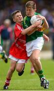 5 July 2015; Tom Doyle, Monastery NS, Killarney, Kerry, is tackled by Daire de Búrca, Gaelscoil na Dubhglaise, during the Munster GAA Primary Game. Munster GAA Football Senior Championship Final, Kerry v Cork. Fitzgerald Stadium, Killarney, Co. Kerry. Picture credit: Stephen McCarthy / SPORTSFILE
