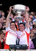 21 September 2008; Tyrone players Colm, left, and Sean Cavanagh lift the Sam Maguire Cup after victory over Kerry. GAA Football All-Ireland Senior Championship Final, Kerry v Tyrone, Croke Park, Dublin. Picture credit: Brendan Moran / SPORTSFILE