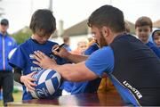 8 July 2015; Jamie Heaslip and Sean O'Brien of Leinster Rugby came out to the Bank of Ireland Summer Camp to meet up with some local young rugby talent in Terenure College RFC. Pictured is Sean O'Brien signing autographs for participant Jack Cooney, from Rathfarnham, at the camp. Terenure RFC, Terenure, Dublin. Picture credit: Brendan Moran / SPORTSFILE