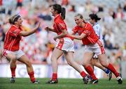 28 September 2008; Ciara O'Sullivan, centre, Cork, is congratulated by team-mates Valerie Mulcahy, left, and Mary O'Connor after scoring their side's second goal. TG4 All-Ireland Ladies Senior Football Championship Final, Cork v Monaghan, Croke Park, Dublin. Picture credit: Brendan Moran / SPORTSFILE
