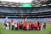 28 September 2008; The Cork team and supporters celebrate with the Brendan Martin cup after victory over Monaghan. TG4 All-Ireland Ladies Senior Football Championship Final, Cork v Monaghan, Croke Park, Dublin. Picture credit: Brendan Moran / SPORTSFILE