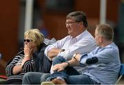 10 July 2015; Former Ireland Manager Roy Torrens, centre, watching the game. ICC World Twenty20 Qualifier 2015, Ireland v Namibia. Stormont, Belfast. Picture credit: Oliver McVeigh / ICC / SPORTSFILE