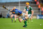 12 July 2015; James Quigley, Tipperary, in action against Seamus Flanagan, Limerick. Electric Ireland Munster GAA Hurling Minor Championship Final, Limerick v Tipperary. Semple Stadium, Thurles, Co. Tipperary. Picture credit: Stephen McCarthy / SPORTSFILE