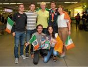13 July 2015; Ireland's Thomas Barr pictured with his training group, from clockwise, David O'Shea, Eoin Synnott, Hayley Harrisson, Clare Murphy, Jessie Barr and Paul Byrne, in Dublin Airport on his arrival home from the World University Games in Gwangju South Korea. Dublin Airport, Dublin. Picture credit: Piaras Ó Mídheach / SPORTSFILE